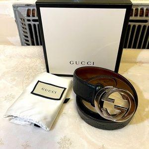 GUCCI logo embossed black leather belt